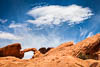 Natural arch and white cloud, Valley of Fire State Park, Nevada, United States, USA, Copyright (c) Daniel Haller - light-phenomenon.com. All rights reserved.
